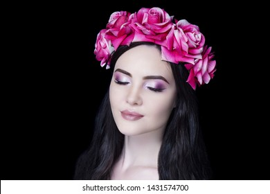 Young beautiful girl, massive accessory flowers crown. Big eyes dreamy closed. Professional make-up bright shiny glitters shadows pencil technique smoky eyes, good shape eyebrows, matte beige lipstick