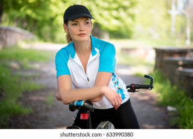 Young beautiful girl on a bicycle