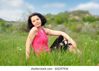 Young, beautiful girl on a green meadow
