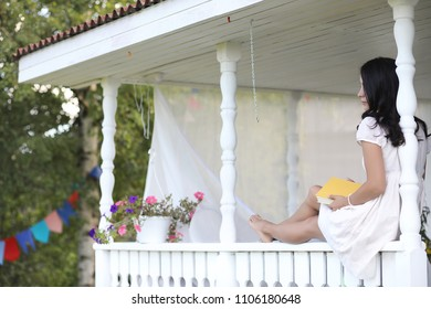 Young beautiful girl on a porch