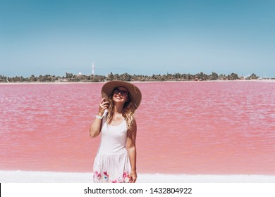 Young beautiful girl on a salt pink lake in Mexico. Las Coloradas Yucatan. Mexican Vacation.