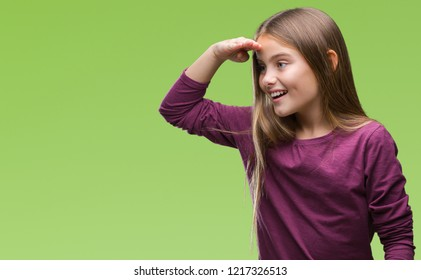 Young beautiful girl over isolated background very happy and smiling looking far away with hand over head. Searching concept.