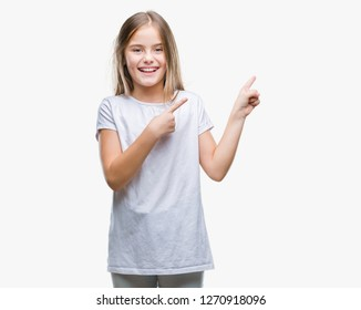 Young beautiful girl over isolated background smiling and looking at the camera pointing with two hands and fingers to the side.