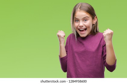 Young beautiful girl over isolated background celebrating surprised and amazed for success with arms raised and open eyes. Winner concept.