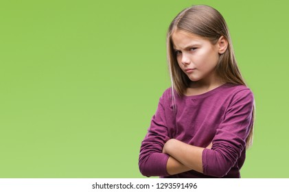 Young beautiful girl over isolated background skeptic and nervous, disapproving expression on face with crossed arms. Negative person.