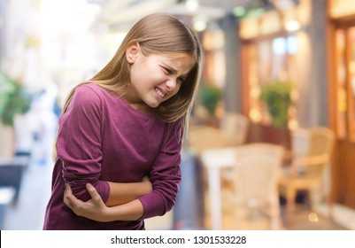 Young beautiful girl over isolated background with hand on stomach because nausea, painful disease feeling unwell. Ache concept.