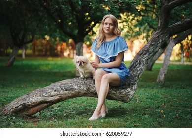 young beautiful girl with pekingese