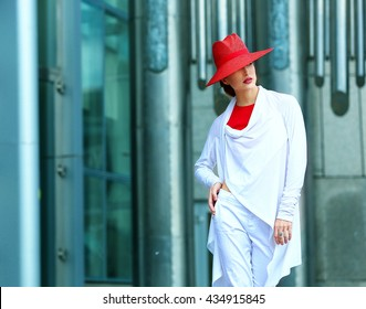 Young beautiful girl with perfect make-up, red lips, wearing a red  hat