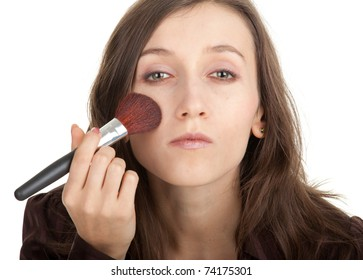 young beautiful girl with perfect skin that apply powder brush