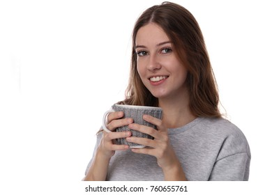 Young beautiful girl with perfect smile holding cozy mug isolated od white backgroud
