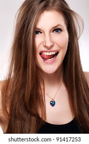 Young and beautiful girl with piercing in tongue