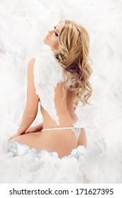 young beautiful girl posing as an angel