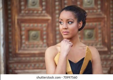 Young beautiful girl posing in modern dress