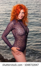 Young beautiful girl posing on the beach