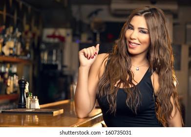 Young Beautiful Girl Posing in a Pub