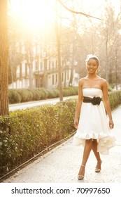 Young beautiful girl posing in white dress