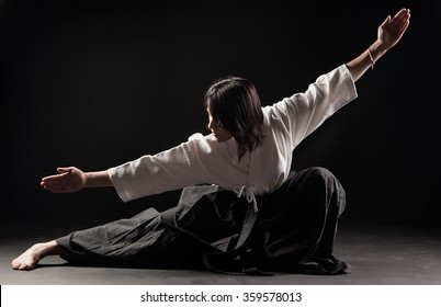 Young, beautiful girl practicing Aikido