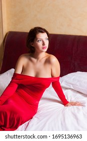 Young beautiful girl in red dress