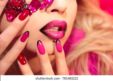 Young beautiful girl with red rose make-up and manicure closeup.