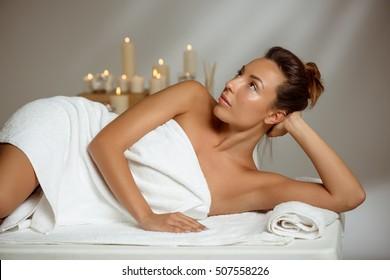 Young beautiful girl relaxing in spa salon.