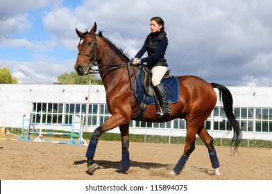 Young beautiful girl riding a running horse