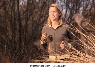 Young beautiful girl running in the autumn environment.