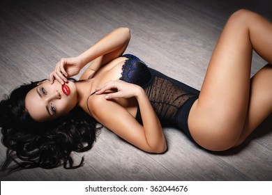 Young beautiful girl in sexy black lingerie