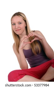 young beautiful girl showing heart symbol with her hands