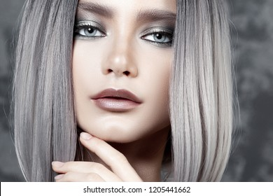 Young beautiful girl with silver make-up and ash hair. Beauty close-up portrait