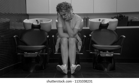 Young beautiful girl sitting in armchair with washbasin in professional salon