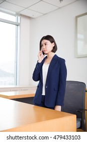 young beautiful girl, sitting in the office began her work