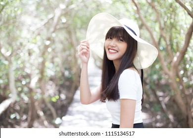 Young beautiful girl smiling and enjoy her strolling along the trail