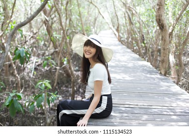 Young beautiful girl smiling and enjoy her relaxing along the trail