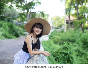 Young beautiful girl smiling and relaxing in her holiday