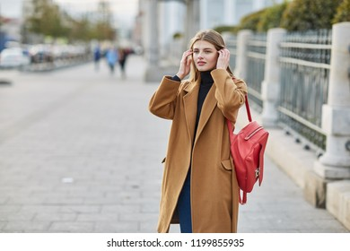 Young beautiful girl standing in the center of Moscow. Portrait of Russian girl. Close up. autumn