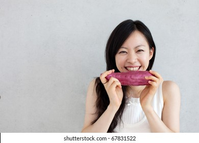 young beautiful girl with sweet potato