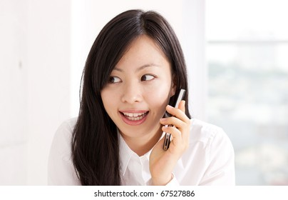 young beautiful girl talking with mobile phone