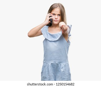 Young beautiful girl talking on the phone over isolated background pointing with finger to the camera and to you, hand sign, positive and confident gesture from the front