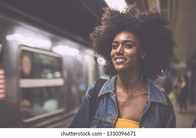 Young beautiful girl walking in Time square metro station,getting the train. Lifestyle concepts about New york