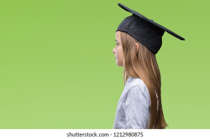 Young beautiful girl wearing graduate cap over isolated background looking to side, relax profile pose with natural face with confident smile.