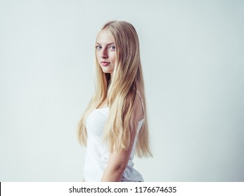 Young beautiful girl woman blonde long hair happy natural with beauty skin and eyes