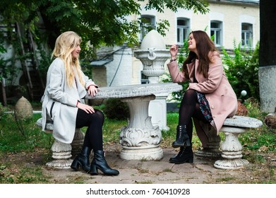 Young beautiful girls friends have some fun conversation