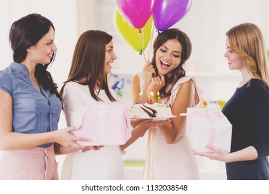 Young Beautiful Girls Have Fun at Birhtday Party at Home. Celebration Birthday at Home. Enjoing Party Together. Party for Beautiful Girls in Modern House. Woman Friendship Concept.