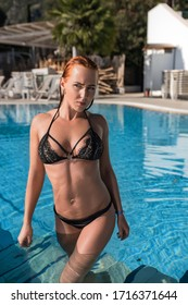 Young beautiful gorgeous fit bikini model pose at Corfu Greece coming out from swimming pool