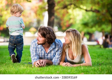 Young beautiful happy family at the park