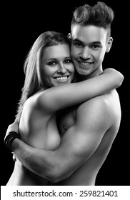 Young beautiful happy smiling couple on black
