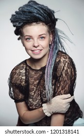 Young beautiful happy smiling sexy girl with dreadlocks