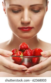 Young beautiful happy smiling woman with strawberry