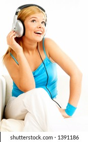 Young beautiful happy women listening music in headphones