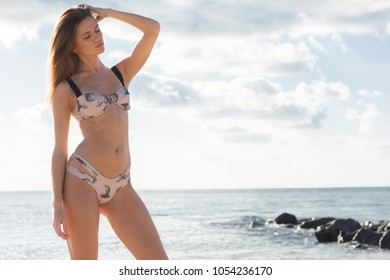 Young beautiful healthy girl enjoy sunny day at the beach.